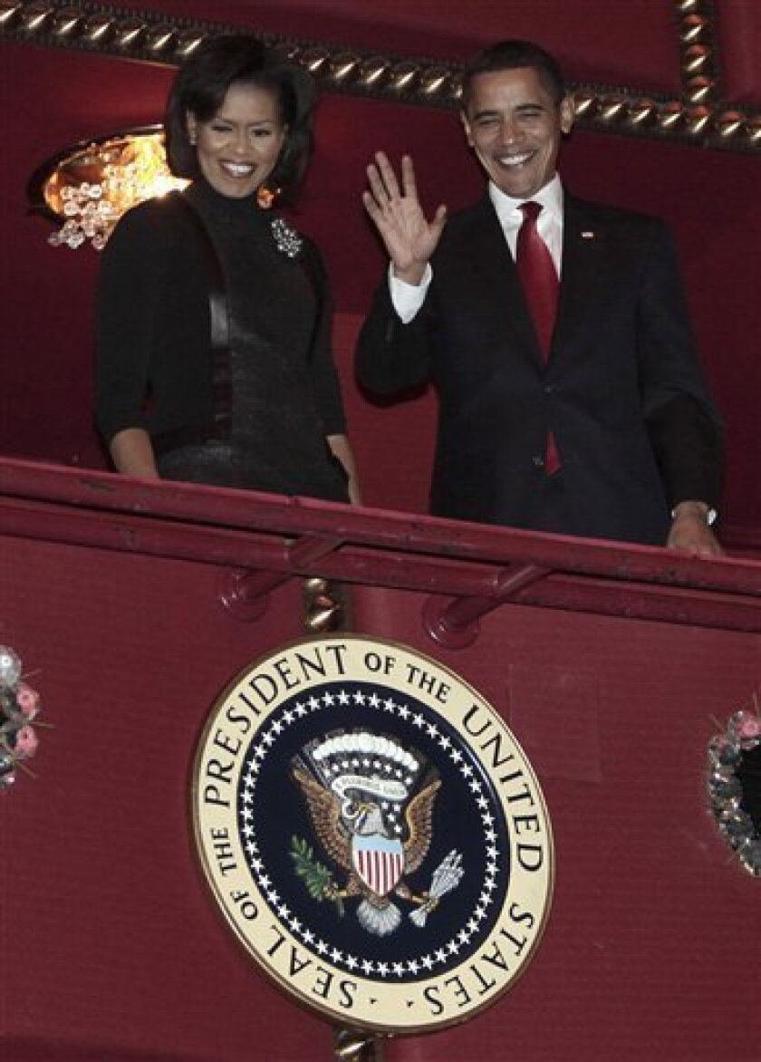 President Barack Obama and first lady Michelle Obama arrive at the Kennedy Center for the the Alvin Ailey American Dance Theater performance Friday, Feb. 6, 2009 in Washington. (AP Photo/Evan Vucci)