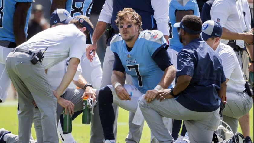 Titans quarterback Blaine Gabbert is checked by the Titans medical staff on Sept. 23.