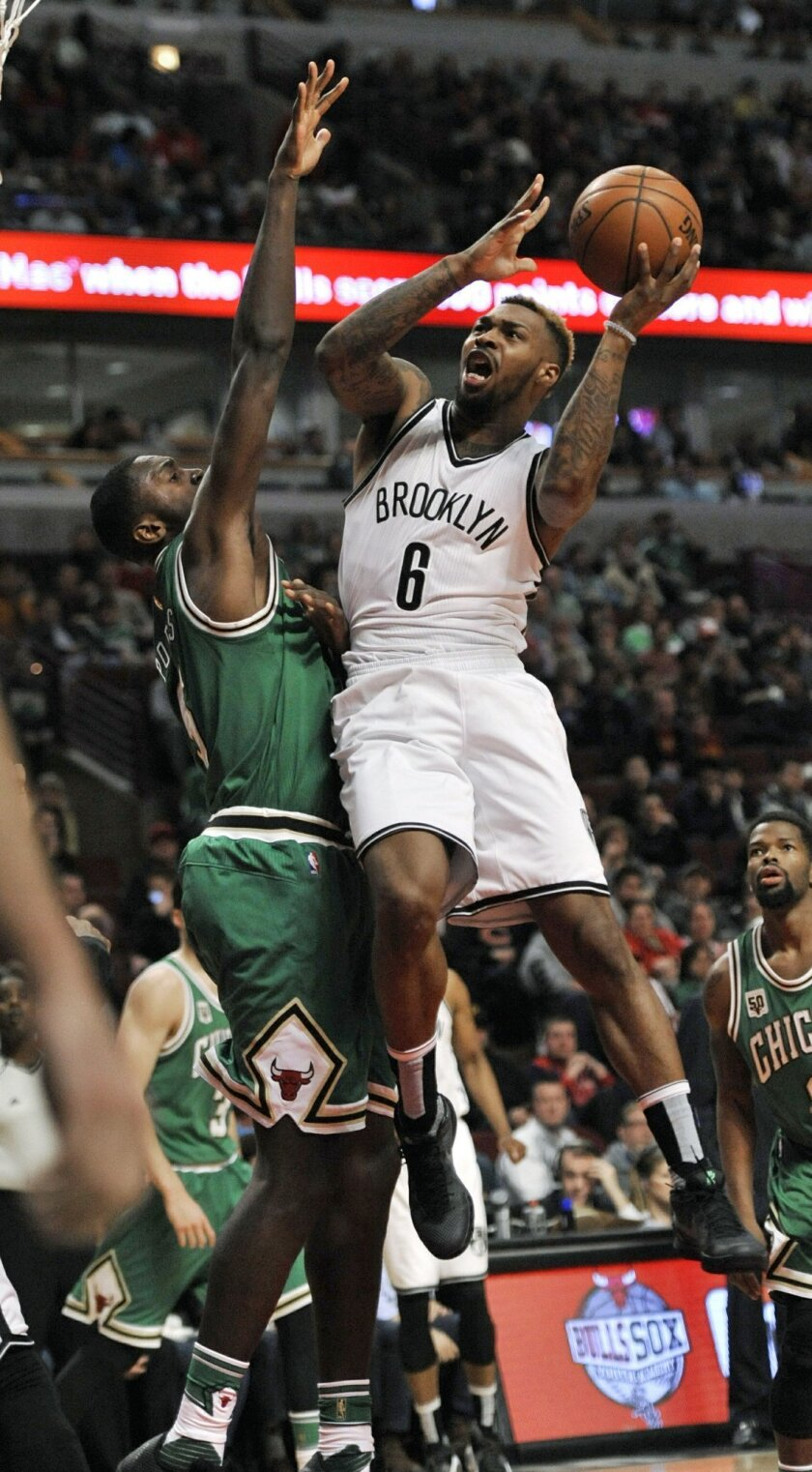 Brooklyn Nets' Sean Kilpatrick (6) goes up for a shot against Chicago Bulls' Bobby Portis (5) during the second half of an NBA basketball game Thursday, March 17, 2016, in Chicago. Chicago won 118-102. (AP Photo/Paul Beaty)