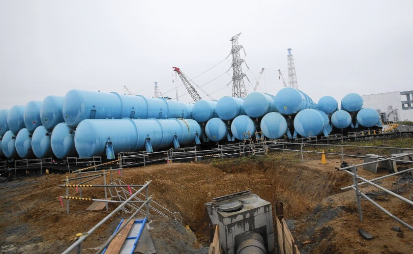 Contaminated water is stored in tanks at the quake-damaged Fukushima Daiichi nuclear power plant in Japan. Three and a half years after the Fukushima disaster, many families remain stressed and divided.