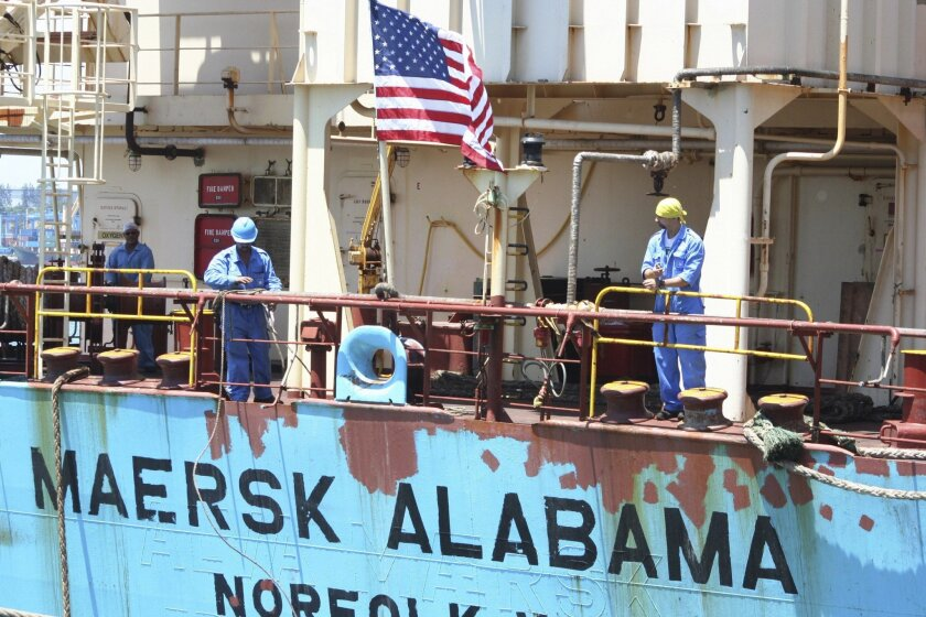 FILE - In this Nov. 22, 2009 file photo, crew members work aboard the U.S.-flagged Maersk Alabama after the ship docked in the harbour of Mombasa, in Kenya. Police in the Indian Ocean island nation of Seychelles said Wednesday, Feb. 19, 2014 that two American security officers were found dead Tuesd