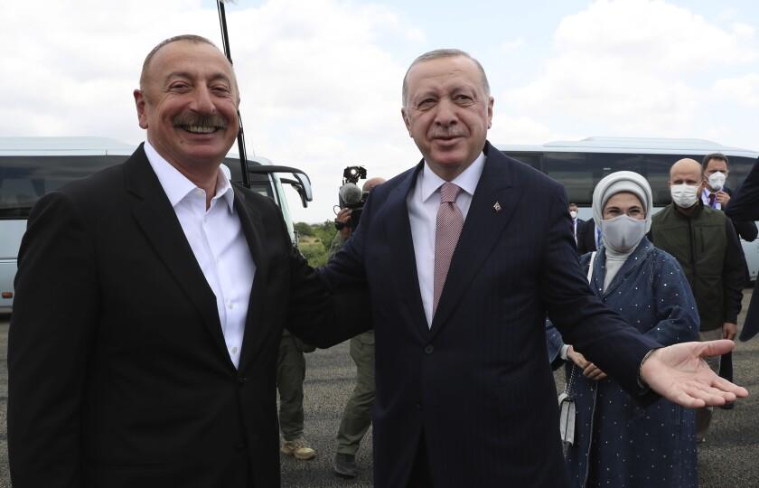 Azerbaijani President Ilham Aliyev, left, and Turkey's President Recep Tayyip Erdogan speak to the media in Fuzuli, in Nagorno-Karabakh, Azerbaijan, Tuesday, June 15, 2021. Fuzuli is city that Azerbaijan liberated from Armenian forces in last autumn's war. Fuzuli came under Armenian control in 1992 in fighting over the separatist Nagorno-Karabakh region.(Turkish Presidency via AP, Pool)