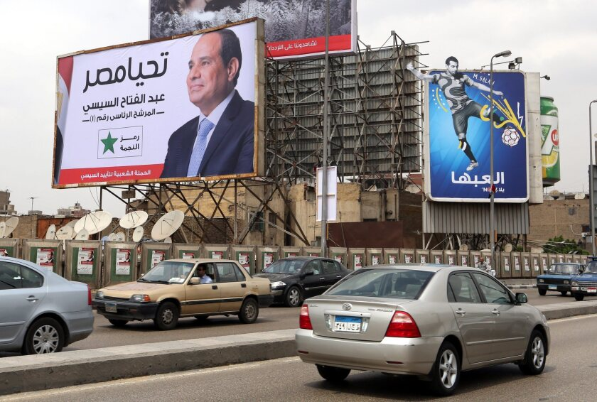 A billboard featuring Egyptian presidential candidate Abdel Fattah Sisi hangs above a Cairo thoroughfare on May 7.