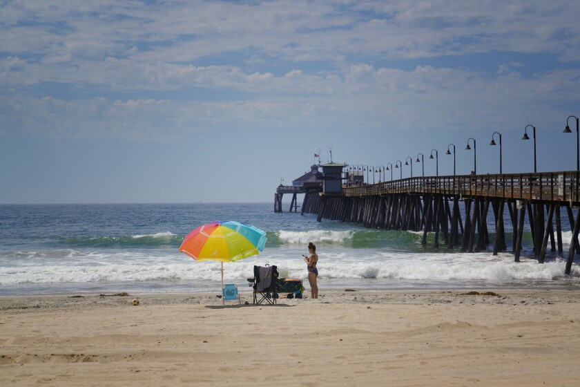 Kristina Boccabella enjoyed the empty sand in Imperial Beach on Wednesday. The weather service expects temperatures and humidity levels to drop around San Diego County through the weekend.