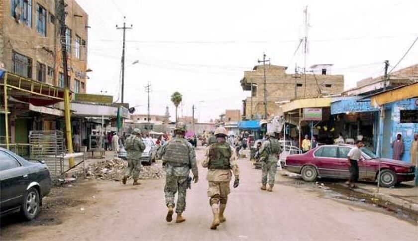 Foot patrol: U.S. soldiers conduct sweeps throught the streets of downtown Balad on Thursday, Oct. 26, 2006.