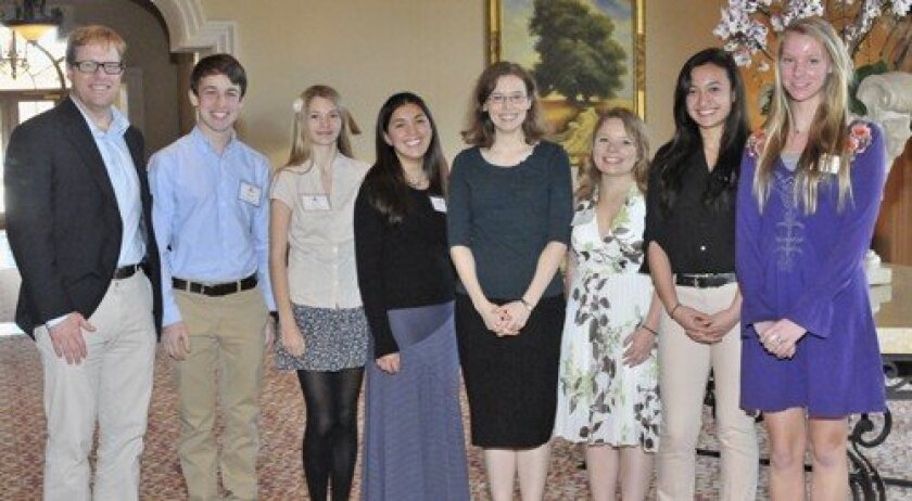 Members of the San Dieguito Academy High School Creative Writing Club enjoyed a private reception with the author.  From left are Rob Ross, Elliot Horen, Jillian Haines, Breanna Schenkhuizen, author Madeline Milller, Erika Shaw, Kendra Brust, Chelsea Kanzler