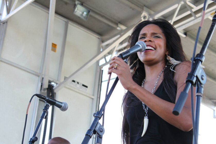 """In this Sept. 28, 2013 photo, New Orleans native and jazz vocalist Anais St. John performs at the Old Algiers Riverfest in New Orleans. St. John is opening the second weekend of the New Orleans Jazz and Heritage Festival on Thursday, May 1, 2014. Jazz Fest runs through Sunday with performances by Christina Aguilera, Chaka Khan, Lyle Lovett, Bruce Springsteen, Trey Songz, Troy """"Trombone Shorty"""" Andrews, John Fogerty and Aaron Neville. (AP Photo/Stacey Plaisance)"""