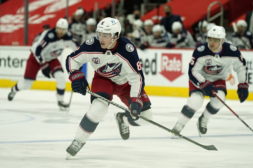 FILE - Columbus Blue Jackets defenseman Zach Werenski skates during the second period of an NHL hockey game against the Detroit Red Wings in Detroit, in this Sunday, March 28, 2021, file photo. The signing of defenseman Zach Werenski to a six-year, $57.5 million contract extension landed with a satisfying boom for Blue Jackets supporters, a team with a reputation for not being able to entice elite young players to stick around.(AP Photo/Carlos Osorio, File)