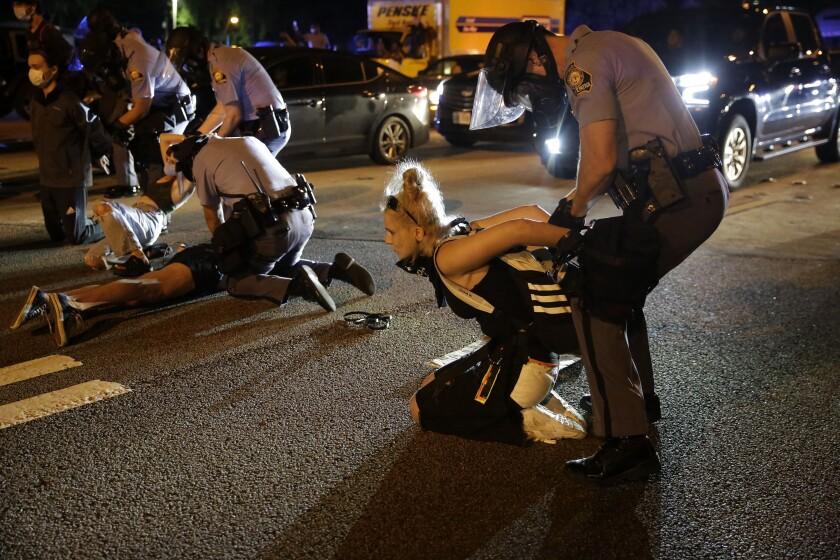 Police arrest protesters Saturday in Atlanta.