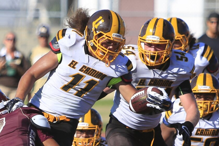 El Camino's Spencer Katoanga fights for yardage early in the season against Point Loma.