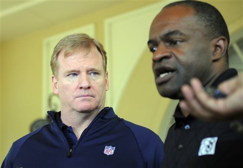 NFL commissioner Roger Goodell, left, and National Football League Players Association executive director DeMaurice Smith, right, speak to the media outside of the Ritz-Carlton hotel after addressing players during the NFLPA rookie symposium on Wednesday, June 29, 2011 in Sarasota, Fla. (AP Photo/B