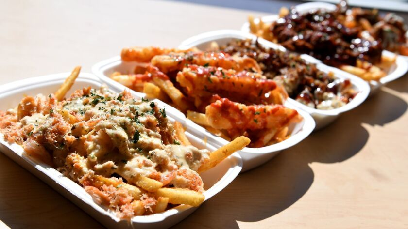 GARDENA, CALIFORNIA FEBRUARY 28, 2017-Lemon garlic snow crab fries, left, along with other choices a
