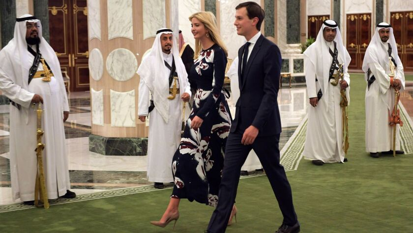 Ivanka Trump (C-L) and Jared Kushner (C-R) arrive to attend the presentation of the Order of Abdulaz