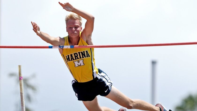 "Marina High school athlete Skyler Magula clears 15'9"", a personal record, in the boys pole vault eve"