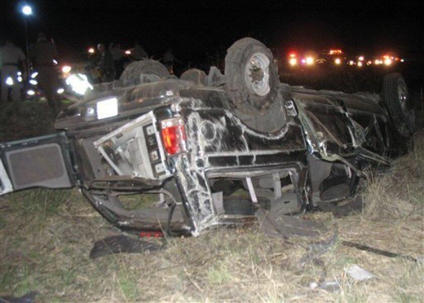 """In this photo released by the Arizona Department of Public Safety shows an overturned 2000 Ford Excursion early Sunday, June 7, 2009 on a remote southern Arizona highway.  Ten undocumented immigrants """"stacked like wood"""" in the back of a sports utility vehicle crammed with at least 22 people were ki"""