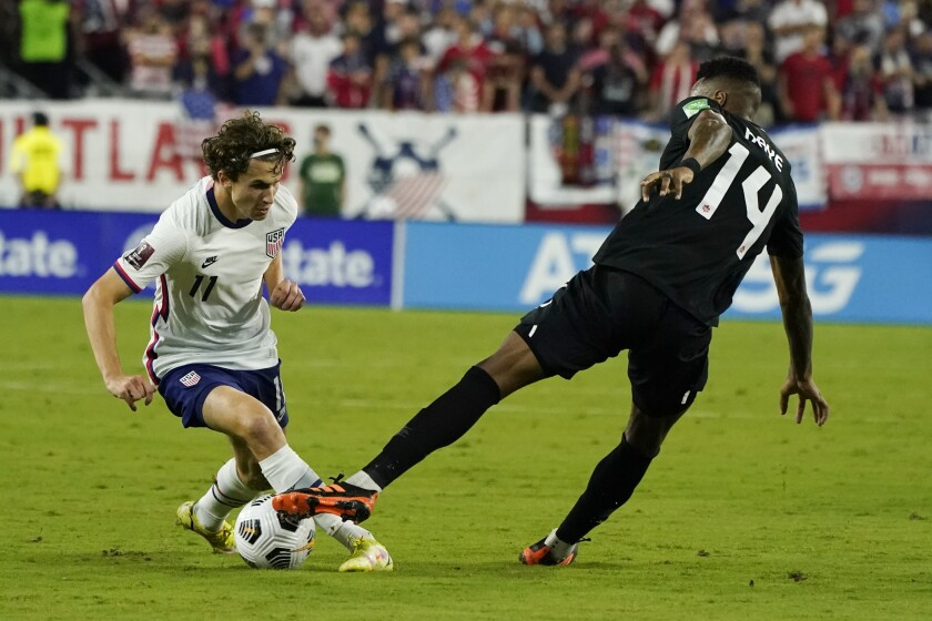 U.S. forward Brenden Aaronson, left, controls the ball in front of Canada midfielder Mark-Anthony Kaye.