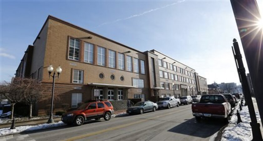 FILE-- This file photo from Jan. 9, 2013,  shows the Steubenville High School in Steubenville, Ohio. Ohio Attorney General Mike DeWine said on Thursday April 25, 2013 that search warrants have been executed at the high school attended by the two football players convicted in this trial. DeWine's of