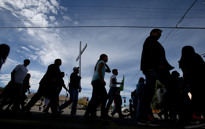 "About 200 people walked the streets of the San Fernando Valley during an immigration reform march and rally on Nov. 27. A new study shows that immigrants are less prone to violence and ""antisocial"" behaviors than native Americans."