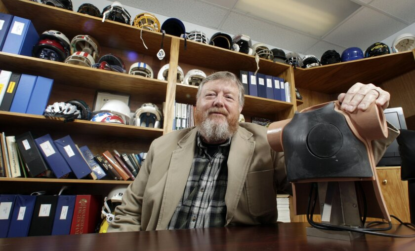 In this March 17, 2016 photo, Dave Halstead poses with a dummy used in developing standards for kids' athletic chest protectors at the National Operating Committee on Standards for Athletic Equipment facility in Rockford, Tenn. Halstead is the technical director for the NOCSAE, which sets safety st