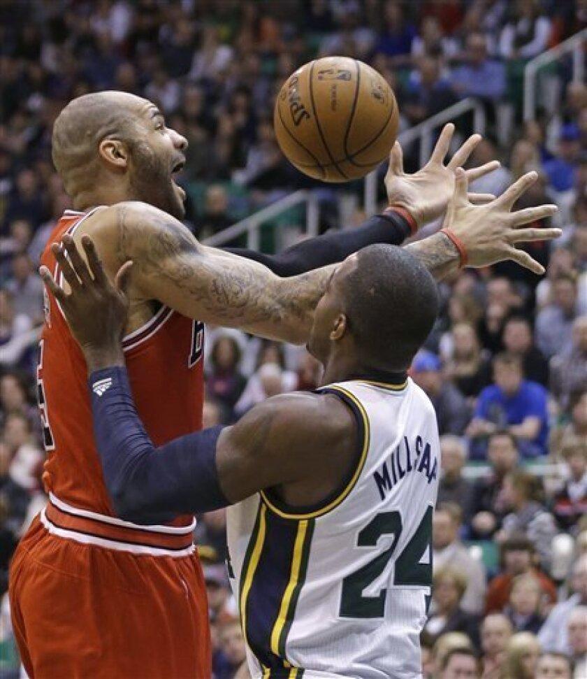 Chicago Bulls' Carlos Boozer (5) loses the ball as Utah Jazz's Paul Millsap (24) defends in the first quarter during an NBA basketball game Friday, Feb. 8, 2013, in Salt Lake City. (AP Photo/Rick Bowmer)