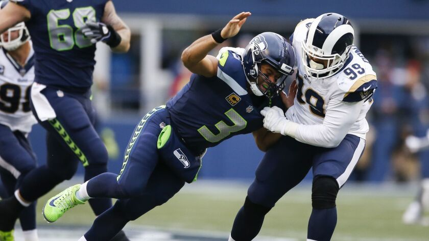 Seattle Seahawks quarterback Russell Wilson (3) is sacked by Rams defensive tackle Aaron Donald in the second quarter on Dec. 17, 2017.