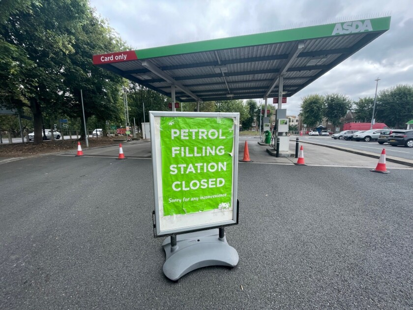 A closed petrol station in Bristol, England, Saturday Sept. 25, 2021. The haulage industry says the U.K. is short tens of thousands of truckers, due to a perfect storm of factors including the coronavirus pandemic, an aging workforce and an exodus of European Union workers following Britain's departure from the bloc. BP and Esso shut a handful of their gas stations this week, and motorists have formed long lines as they try to fill up in case of further disruption. (Ben Birchall/PA via AP)