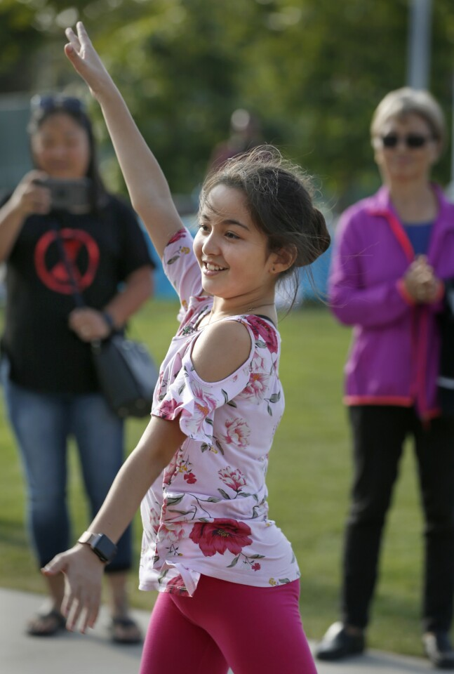 Naomi Coulter, 12, competes in the Costa Mesa ArtWalk + Dance Battle series Saturday at Lions Park. She won the first place prize.