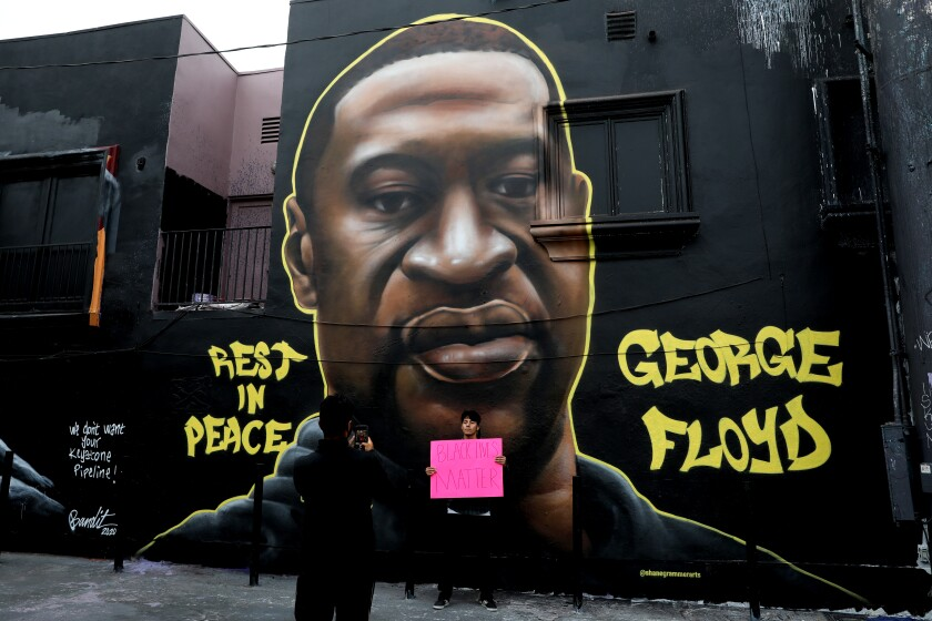 Artists remembered George Floyd with murals and street art on Melrose Avenue.