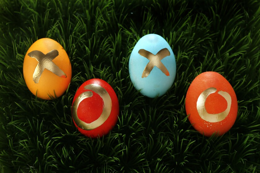 Easter eggs decorated with Kool-Aid dyes and gold paint pens.