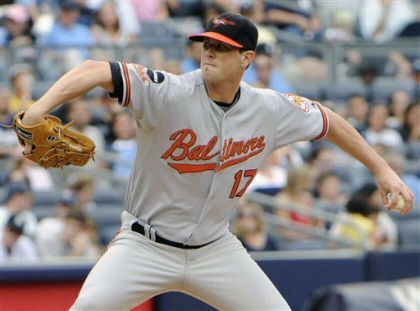 Baltimore Orioles pitcher Brian Matusz delivers to the New York Yankees during the second inning of a baseball game Monday, Sept. 5, 2011, at Yankee Stadium in New York. (AP Photo/Bill Kostroun)
