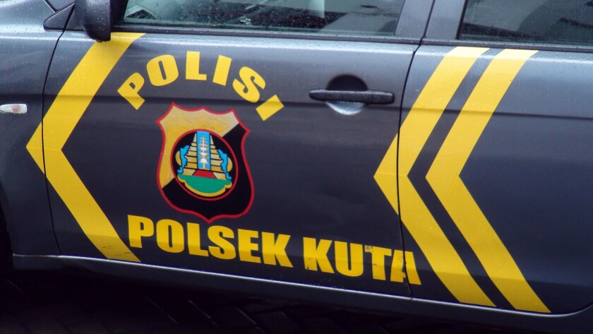 An American woman allegedly threw her 2-month-old daughter from a moving car on the tourist island of Bali and then tried to kill herself by jumping from the vehicle.