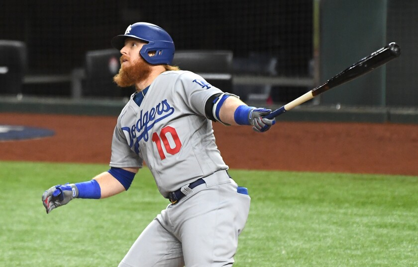 Dodgers third baseman Justin Turner hits a solo home run during the first inning.