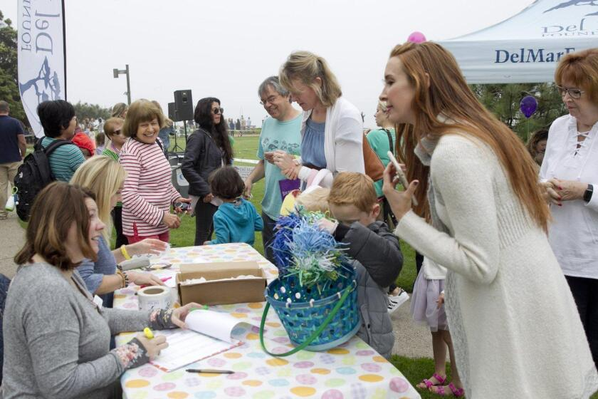 Families check in for the Del Mar Egg Hunt