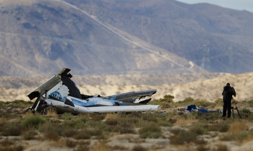 An investigator surveys the scene at the wreckage site of the Virgin Galactic Spaceship Two after it crashed Oct. 31 in the Mojave Desert.