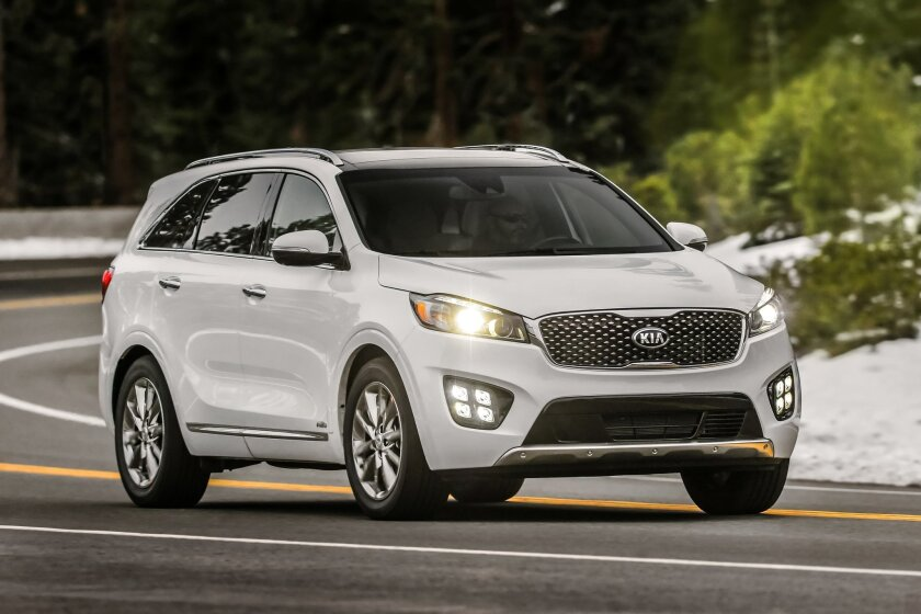 This product image provided by Kia Motors shows the 2016 Sorento 3.3-liter V6 SX-L. For 2016, the Kia Sorento sport utility vehicle is larger than its predecessor, has new, handsome styling and is surprisingly refined. (Kia Motors via AP)