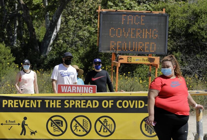 Signs at Eaton Canyon Natural Area Park in Pasadena.