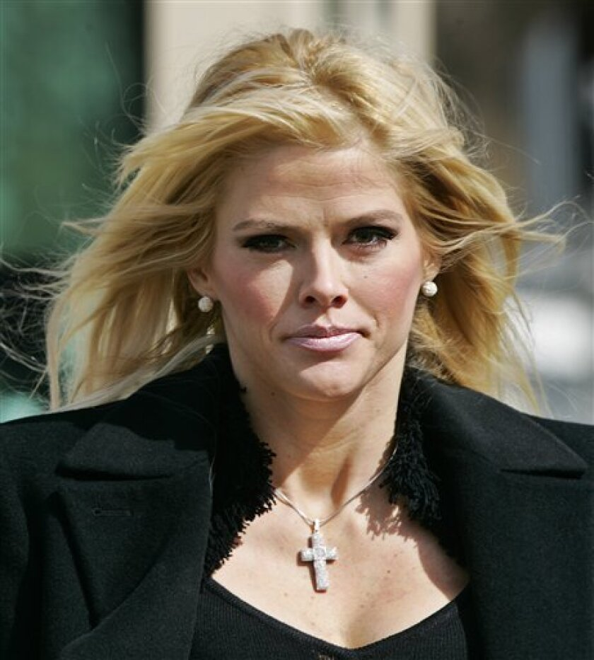 FILE - In this Feb. 28, 2006, file photo, Anna Nicole Smith, leaves the U.S. Supreme Court in Washington. Smith was investigated by the FBI in 2000 and 2001 in the alleged plot targeting E. Pierce Marshall. At the time, he was fighting Smith to keep her from collecting his late father's vast oil fortune. The younger Marshall has since died. (AP Photo/Manuel Balce Ceneta, File)