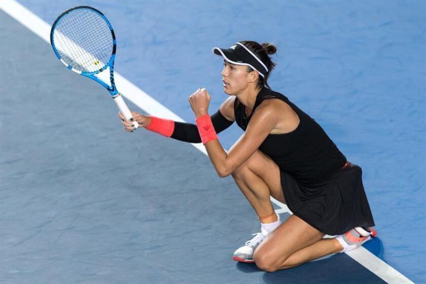 Las jugadores españolas Garbiñe Muguruza, decimoctava favorita, y Carla Suárez, cabeza de serie vigésimo tercera, compartieron un intenso entrenamiento. EFE/Archivo