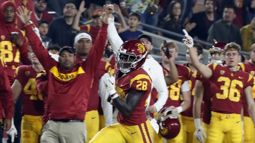 LOS ANGELES, CALIF. .. - NOV. 10, USC running back Aca'Cedric Ware takes the ball down to the Cal si