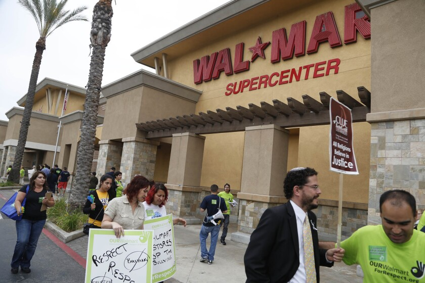 Wal-Mart workers demonstrate in 2013 outside the Pico Rivera store for what they said was retaliation against employees for speaking out.
