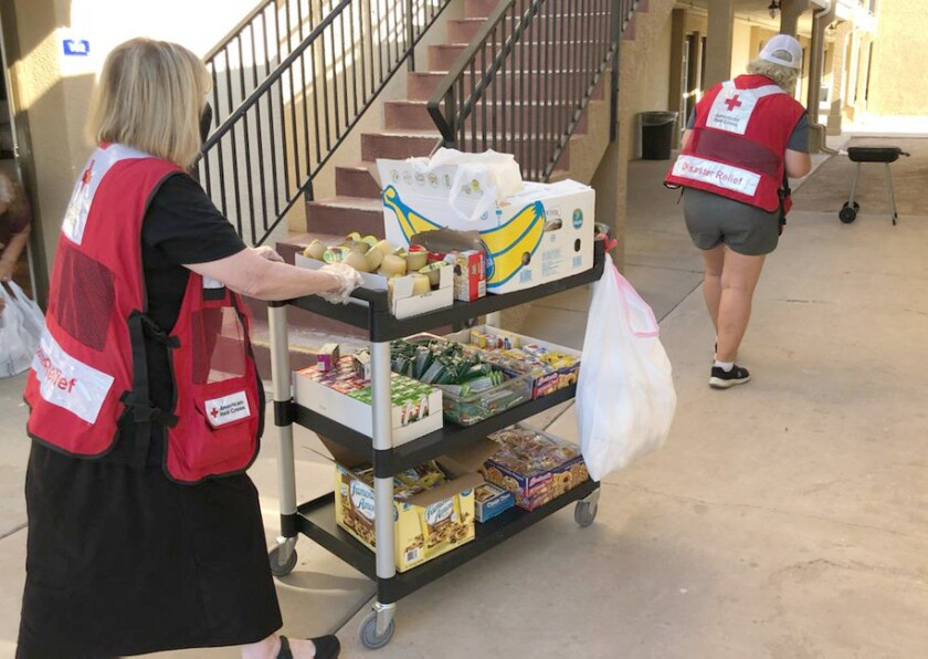 American Red Cross workers provide disaster relief aid.
