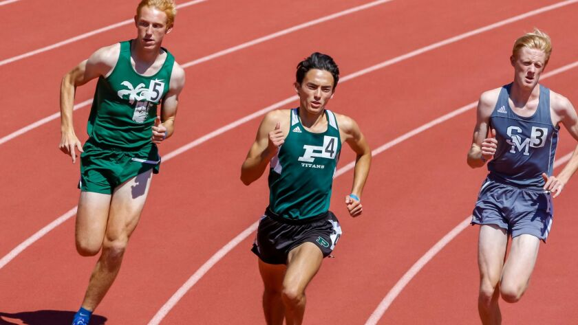 Poway's Jarett Chinn (center) is among the state leaders in the 800 meters.