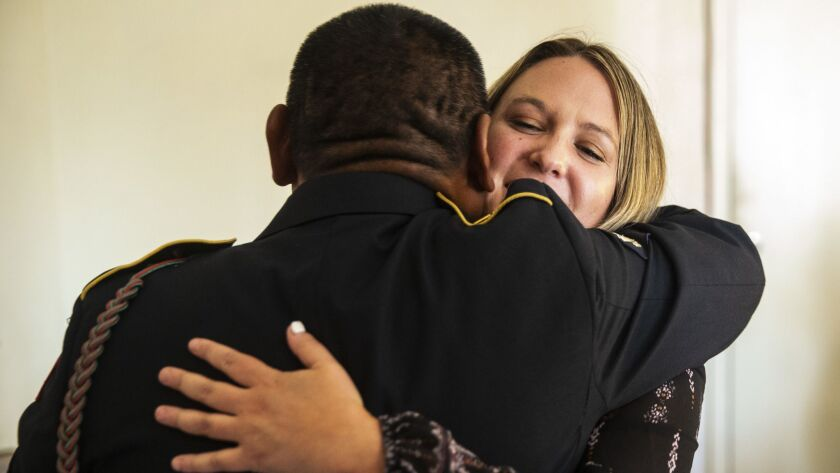 AZUSA, CALIF. - SEPTEMBER 19: Fabian Rebolledo, hugs Danielle Nygrenm 27, who worked on his case whi