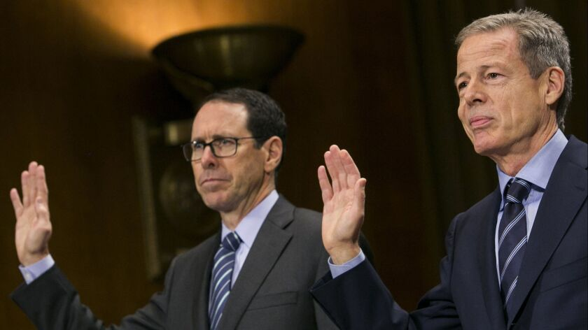 AT&T Chief Executive Randall Stephenson, left, and Time Warner CEO Jeffrey Bewkes are sworn in before testifying about the planned merger of their companies at a 2016 hearing of a Senate Judiciary subcommittee.