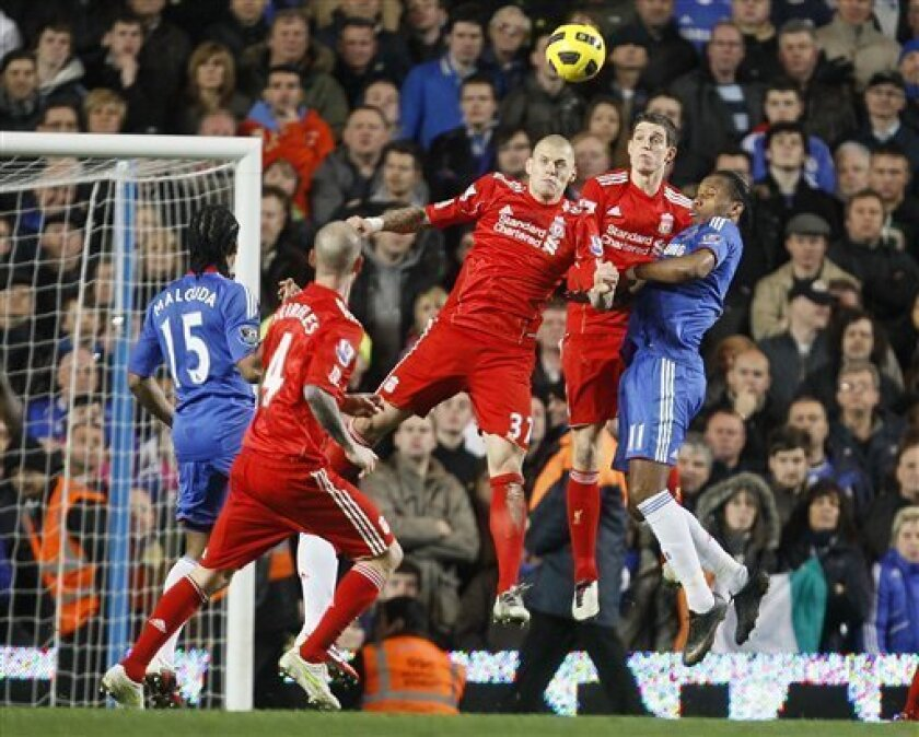 Chelsea's Didier Drogba, right, goes for the ball with Liverpool's Martin Skrtel , No 37, during their English Premier League soccer match at Chelsea's Stamford Bridge Stadium in London, Sunday, Feb, 6 2011 . (AP Photo/Alastair Grant) NO INTERNET/MOBILE USAGE WITHOUT FOOTBALL ASSOCIATION PREMIER LEAGUE(FAPL)LICENCE. CALL +44 (0) 20 7864 9121 or EMAIL info@football-dataco.com FOR DETAILS
