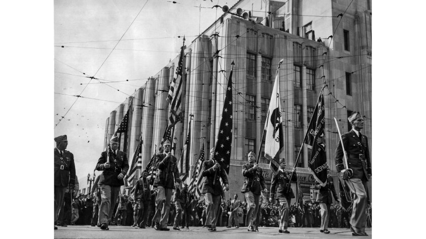 Nov. 11, 1937: A contingent of the Mail Carriers Legion Post turn onto Spring St. from First St. in
