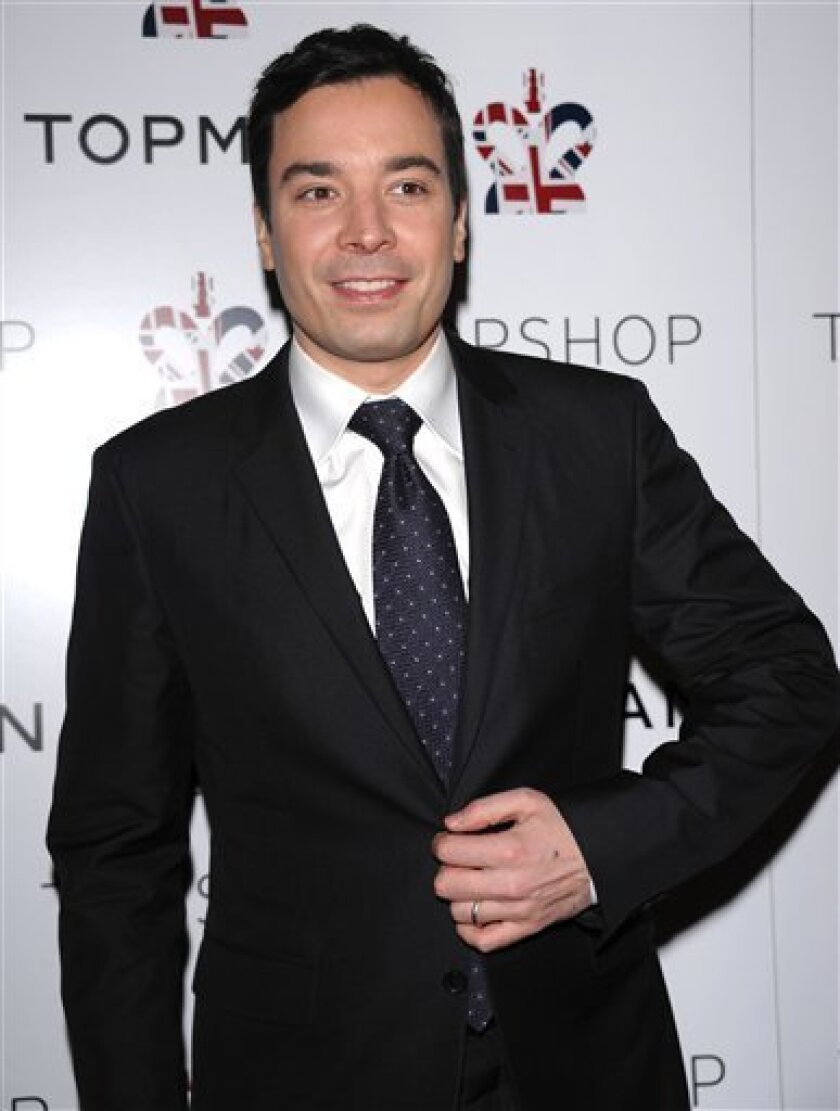 FILE - In this March 31, 2009 file photo, talk show host Jimmy Fallon attends a private dinner to celebrate the opening of the new TOPSHOP TOPMAN Flagship store in New York. (AP Photo/Evan Agostini, file)