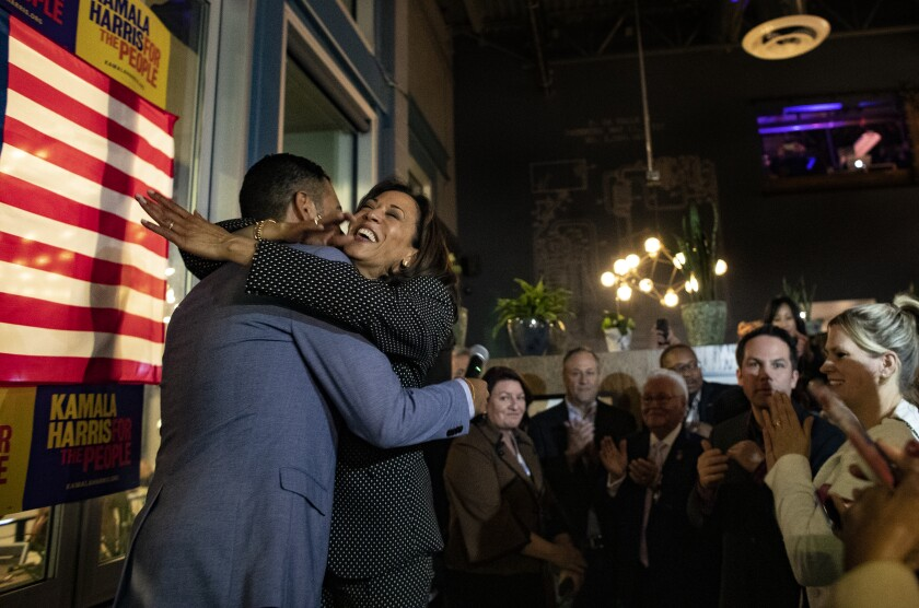 Sen. Kamala Harris hugs Long Beach Mayor Robert Garcia