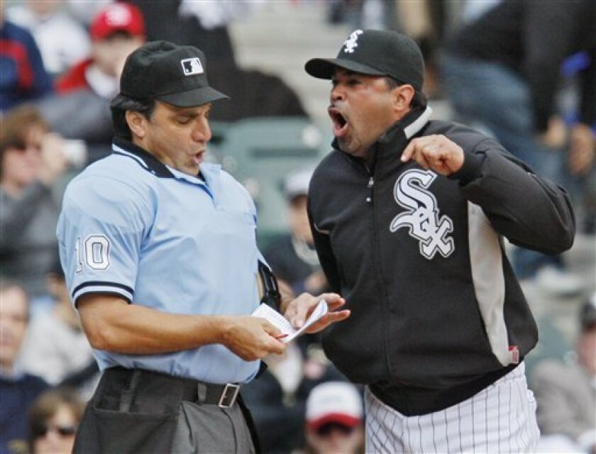 Chicago White Sox manager Ozzie Guillen argues with home plate umpire Phil Cuzzi after being ejected during the third inning of a baseball game against the Minnesota Twins' Monday April 7, 2008 in Chicago. (AP Photo/M. Spencer Green)
