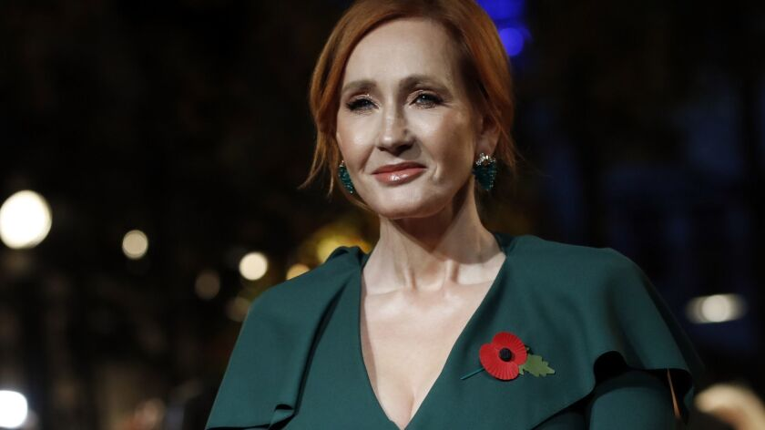 """Writer J.K. Rowling poses at the world premiere of the film """"Fantastic Beasts: The Crimes of Grindel"""